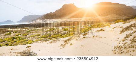 Amazing Sunset Over Volcanic Mountains On Desolated Atlantic Coast. Sunrays Falling On Coastal Dunes