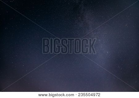 Blue Night Starry Sky Background. Night View Of Natural Glowing Stars Of Milky Way. View From Easter