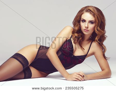 Attractive Young Woman In A Perfect Shape. Gorgeous Girl Posing In Erotic Lingerie. Sexy Fashion Mod
