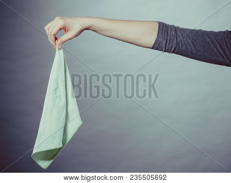 Smell Disgusting Filth Hygiene Odor Concept. Person Holding Smelly Rag. Female Arm Keeping Filthy Ti