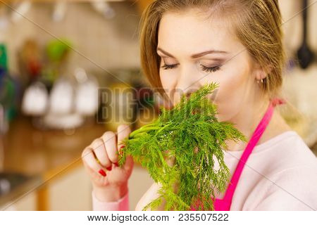 Young Female Holding Herbs. Pretty Woman Having Dill Herb Smelling It Scent.