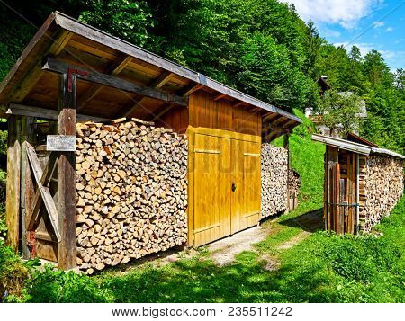 Hallstatt, Austria. Wood stack with stacked firewood stock for winter heating.