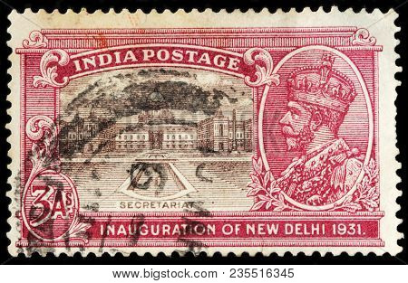 Luga, Russia - February 8, 2018: A Stamp Printed By India Shows Portrait Of King George V And View O