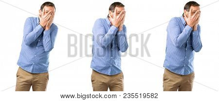 Middle age handsome man smiling having shy look peeking through her fingers, covering face with hands looking confusedly broadly over white background