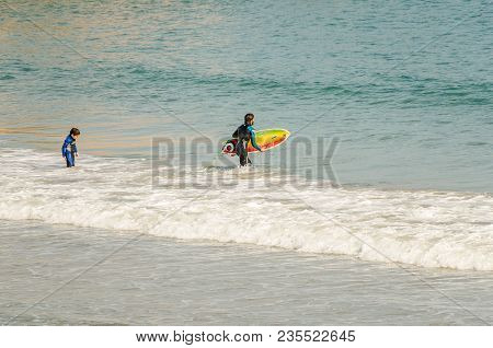 Father And Son Practice Windsurfing On The Beach Of Cado Roig E In Alicante, Spain One Day Of 2013