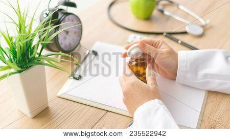 Female Doctor Holding Unlabeled Bottle Of Various Pills And Medication, Generic Drugs Concept, Presc