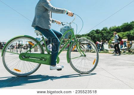 A Stylish Man Rides A Beautiful City Park Bike Ride. Walk On A Bike. Active Rest. Walking Bicycle.