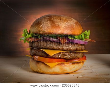 Double cheese burger and red onion on rustic