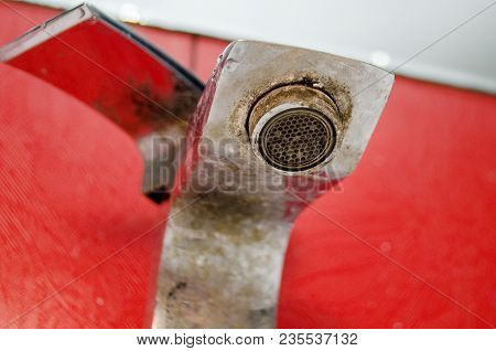 Solid Water And Rust On The Washbasin In The Bathroom
