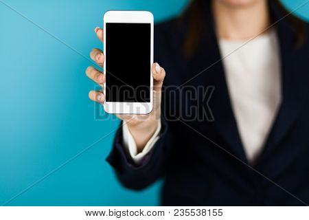 Female hand holding a phone