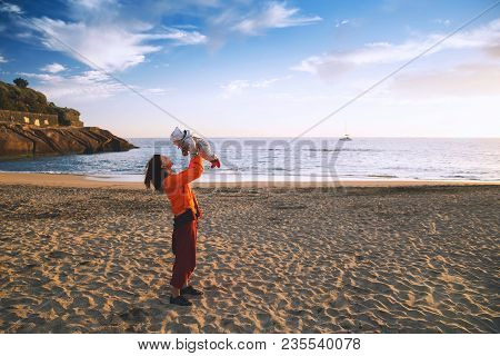 Family Holiday On Tenerife, Spain, Europe. Mother And Baby Outdoors On Ocean. Portrait Travel Touris