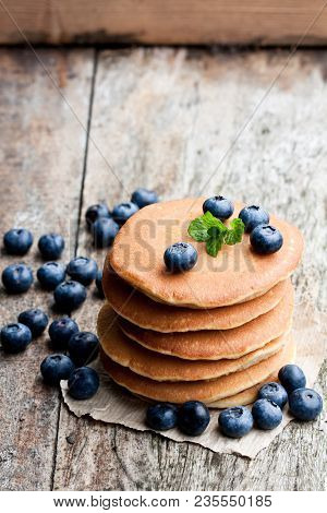 Stack  Of Scotch Pancakes With Fresh Blueberry On Wooden Table