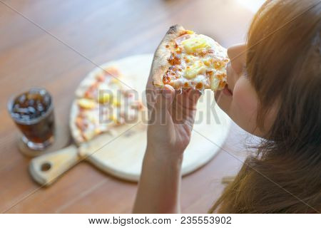 Woman Eating Tasty Pizza And Soft Drink In Restaurant. Top View. Young Girl Eating A Piece Of Delici