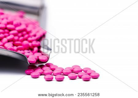 Pile Of Pink Round Sugar Coated Tablets Pills On Drug Tray With Copy Space. Pills For Treatment Anti