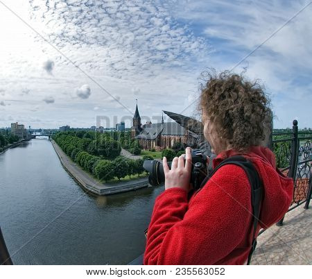 The Woman Photographs Historical Center And Cathedral Church On Kant Island In Kaliningrad