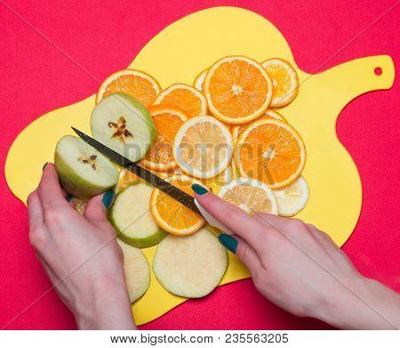 Fruit Lying On A Cutting Board