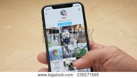 Hong Kong, Hong Kong, 05 March 2018:- Use of iphoneX with the hashtag of dog