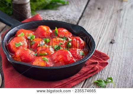 Meatballs In Tomato Sauce In A Cast-iron Frying Pan On A Wooden Table, Horizontal, Copy Space