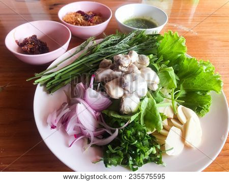 Oysters With Spicy Sauce And Herbs, Acacia, Sliced Onion, Parsley, Sliced Garlic. This Is Thai Spicy