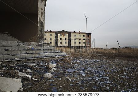 Outskirts. Abandoned construction. Unfinished building. Grunge landscape. Grunge architecture. Grunge style. Grunge building. Urban grunge. Grunge architecture. Grunge buildings.