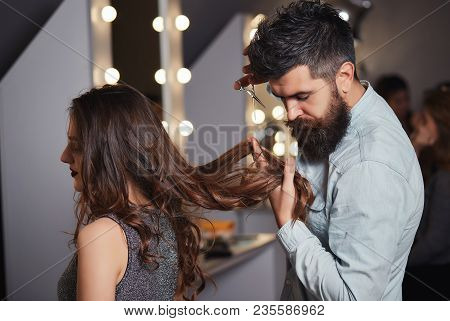 Bearded Male Hairdresser Cutting Clients Hair With Scissors At Hair Salon. Hairdresser Cutting Hair,