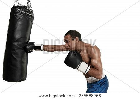 Sporty Man During Boxing Exercises Making Direct Hit. Photo Of Boxer On White Background. Strength,