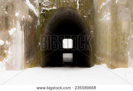 Passage Through A Dark Tunnel At The End Of Which The Light Is Shining