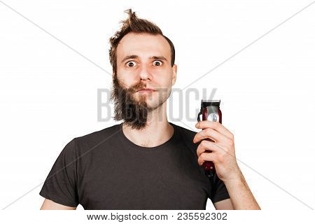 Man With Half-shaved Beard Surprised With Wide Eyes Holding Hair Clipper. Isolated On White.