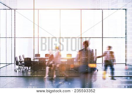 Modern Office Interior With Glass Walls, Panoramic Windows, A Conference Room And Business People Wa