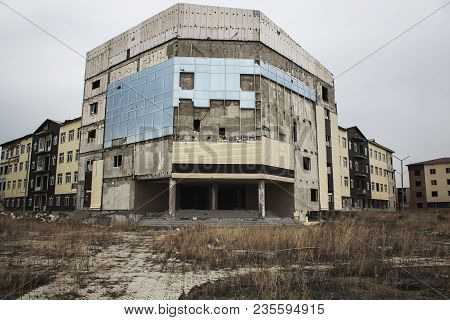 Abandoned construction. Unfinished building. Architectural background. Grunge building. Urban grunge. Grunge style. Grunge architecture. Grunge buildings.