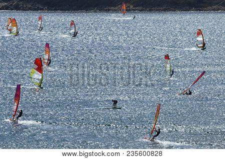 Windsurfers Rides On The Brilliant Waves Of The Beautiful Mediterranean Sea On Cape Prasonisi (rhode