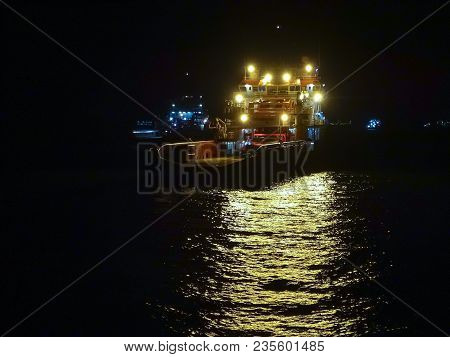 Night View Of Offshore Oil & Gas Sea Construction & Support Vessels In Labuan,malaysia. All The Vess