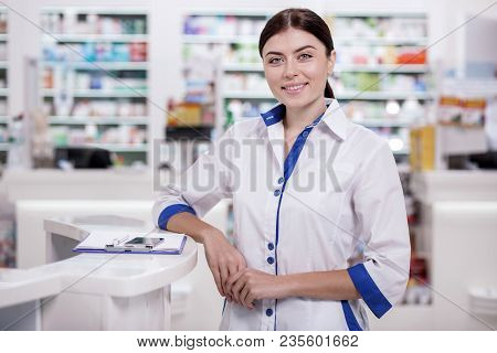 Great Drugstore. Attractive Female Pharmacist Female Pharmacist Standing In Drugstore While Looking