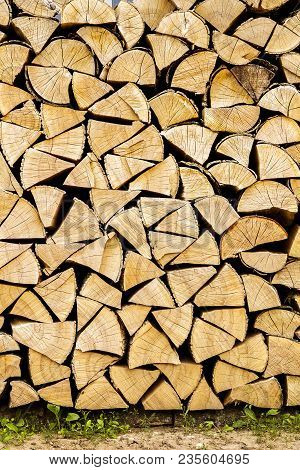 Firewood Placed On The Ground. Chopped Firewood For The Fireplace.wood Texture. Preparation Of Wood