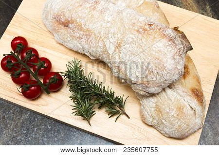 Ciabatta Bread A Traditional Italian Ciabatta Bread On A Wooden Chopping Board