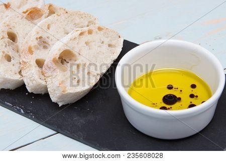 Ciabatta Bread A Traditional Italian Ciabatta Bread On A Wooden Chopping Board With Oil And Balsamic
