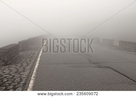Road In The Fog. Thick Fog And Empty Road. Mystic Foggy Road. Place For Text. The Etna Volcano. The