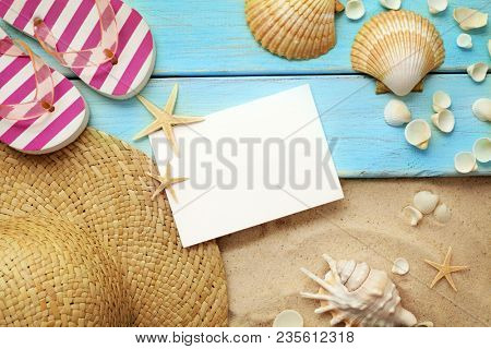 beach wear and accessories. summer hat, sandals and seashells