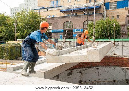 Tyumen, Russia - July 31, 2013: Jsc Mostostroy-11. Construction Of A 18-storeyed Brick Residental Ho
