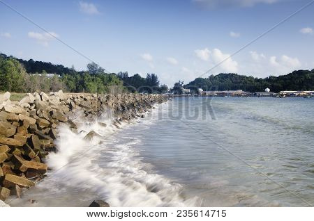 Concrete Breakwater Along The Coastline To Protect Mainland From Heavy Waves During Monsoon Season