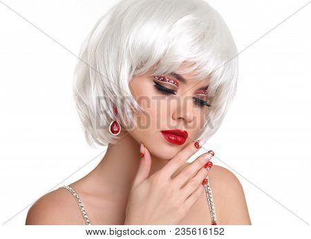 Red Lips Christmas Makeup. Beautiful Blond Girl Closeup Portrait. Manicured Nails. Jewelry. White Sh