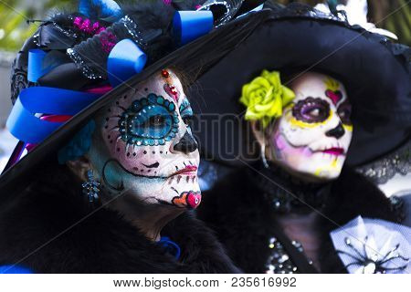 Mexico City, Mexico - October 29,2016: Two Ladies Dress Up As Katrinas Stop For People Take Pictures