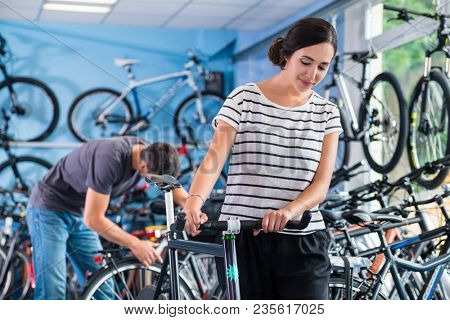 Couple in bike shop looking to buy a bicycle