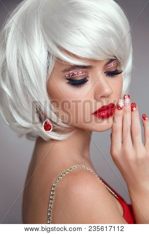 Christmas Makeup. Red Lips Makeup. Beautiful Blond Closeup Portrait. Manicured Nails. Jewelry. White