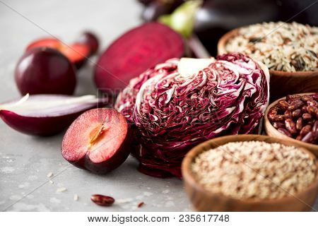 Ingredients For Cooking, Copy Space, Top View, Flat Lay. Purple Vegetables,  Fruits On Grey Background. Violet Eggplant, Beets, Cauliflower, Purple  Beans, ...