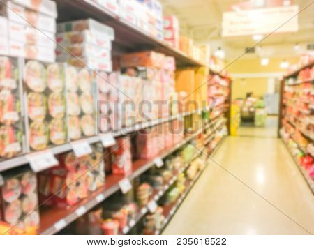 Blurred Pasta, Rice Paper, Instant Noodle On Shelves At Asian Grocery Store In Usa