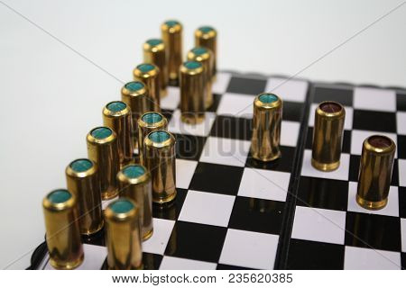 Blind And Gas Bullets On Chessboard Like Black And White Chess Pieces