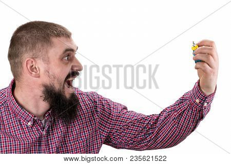 Morning Wake Up Concept. Guy With Furious Face Holds Alarm Clock. Isolated On White Background.