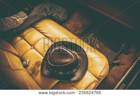Cowboy Classic Ride. Leather Cowboy Hat On The Seat Of Vintage Car.