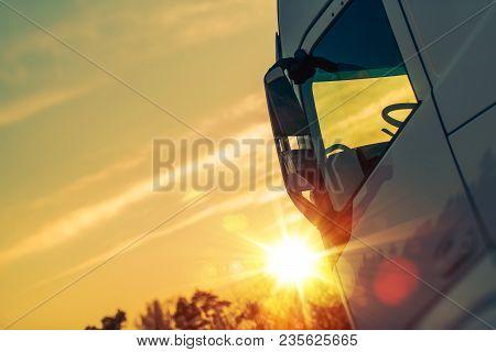 Semi Truck Transport Concept Photo. Semi Truck Cabin And The Sunlight.